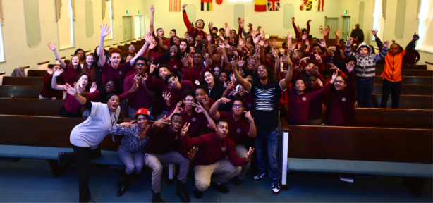 Principal Anchan, Arts Teacher Mrs. Lee, and LCS students take a photo with Christian hip hop artist, Humble Tip.